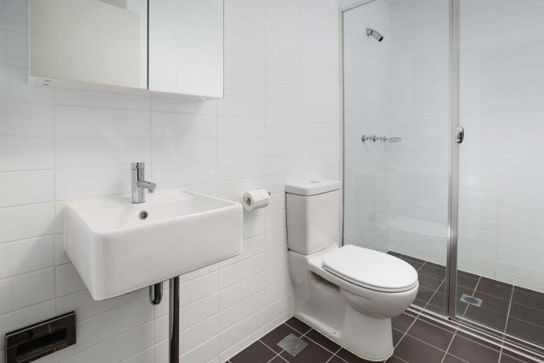 star apartments bathroom with shower and toilet